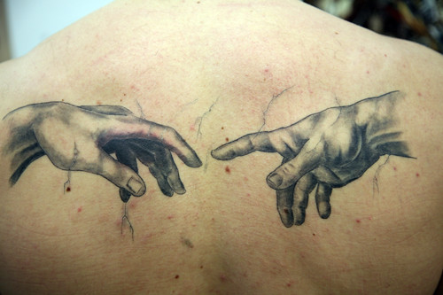 Grey Hands Tattoo by The Tattoo Studio