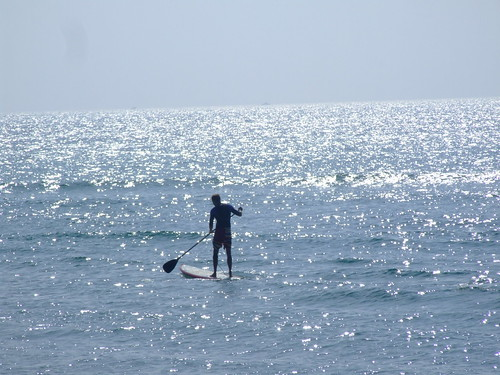 Paddling the board