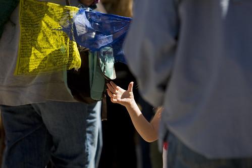 Childs hand near prayer flags