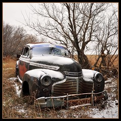 Snow Covered Chevy (Huleo-1) Tags: rural rustic northdakota oldcar prairieghost