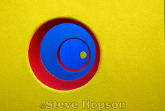 Nested Circles in the Healing Garden (Steve Hopson) Tags: blue red usa abstract color colour eye geometric colors playground yellow architecture hospital austin catchycolors circle geotagged concrete airport nikon flickr texas geometry circles peekaboo perspective vivid tunnel 100v10f amarillo austintexas dell maze squaredcircle forms wormhole portal publicart abstracts tunnels magical timetunnel labyrinth thewall seton eyecandy primarycolors primarycolours 2007 squarecircle throughthelookingglass concentriccircles landscapearchitecture mueller playscape childrenshospital landscapedesign nikond200 stevehopson playscapes healinggarden yellowredblue colorphotoaward dellchildrenshospital colorfulcircles rainbowweek childrenshospitals nestedcircles colourartaward dellchildrensmedicalcenter dellchildrensmedicalcenterofcentraltexas tbgpartners peekaboowall perspectiveabstract