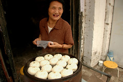 A lady selling dumplings (Rafal Bergman) Tags: china street old grandma people food woman lady xian dumplings selling