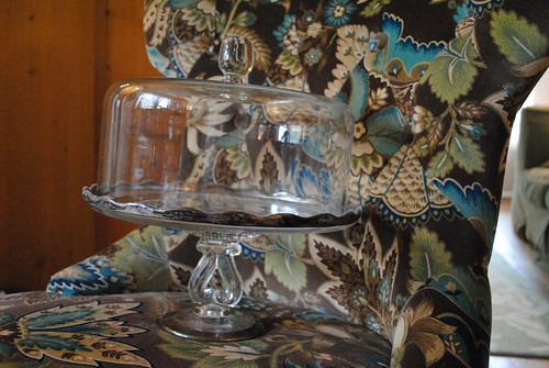 glass cake stand on chair