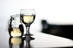 summer wine (helen sotiriadis) Tags: summer food white black reflection glass yellow closeup canon table gold chair dof wine bokeh dry depthoffield greece refraction transparent pitcher tabletop chania canonef50mmf14usm falasarna canoneos40d updatecollection