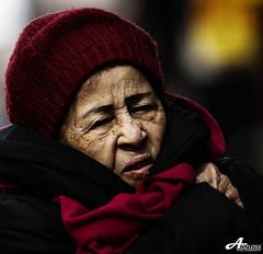Freezing.. (ZiZLoSs) Tags: new york old woman cold canon square eos time freezing usm aziz abdulaziz عبدالعزيز f56l ef400mmf56lusm 450d zizloss المنيع canoneos450d ef400mm 3aziz almanie abdulazizalmanie httpzizlosscom