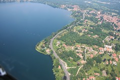 Lago di Monate - Travedona Monate (_ Night Flier _) Tags: above travel blue sky italy panorama lake green nature water airplane landscape flying high view earth top aviation aerial h2o fromabove coastline lombardia varese cessna skyview lombardy birdeye aeronautic travedonamonate lagomonate