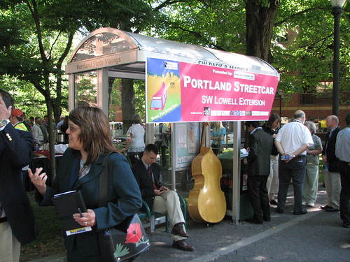 A lone double-bass waits to board the Portland Streetcar