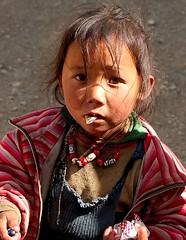 Tibetan Girl near Mount Everest (^^^ ^^^) Tags: poverty china portrait people favorite man art girl person kid highlands nikon flickr child plateau poor culture bodylanguage tibet mount highland human ren tibetan  everest development peopleart   gao chilren smallpeople amateurphotographer underdeveloped tibetangirl underdevelopment 25faves boyandgirls startrooper asianphotographer ysplix tibetanchild ysplixb chinesephotographer amateur