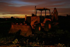 Where Machines Rest (Alex Gilliard) Tags: longexposure sunset tractor yellow canon fire back industrial sundown florida dusk nighttime hoe loader johndeere earthmover 1755 strobist rebelxti alexgilliard