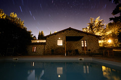 La Pozza at Night (Tyler Westcott) Tags: longexposure italy lightpainting reflection pool night star explore tuscany chianti startrails volpaia sfchronicle96hrs nikond40 lapozzadivolpaia