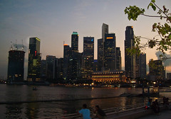 Singapore Skyline (robdeja) Tags: city sunset tower skyline architecture skyscraper lights singapore downtown republic waterfront dusk commercial
