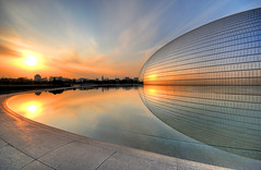 "Beijing Opera House (""The Egg"") -  (5ERG10) Tags: china light sunset red sky orange sun house lake color reflection building glass sergio architecture photoshop reflections gold mirror golden nikon opera asia theater tramonto colours theatre steel alien curves egg sightseeing beijing landmark artificial structure manmade handheld colourful curve operahouse sole frontpage architettura hdr highdynamicrange cina luce peking chine pekin pechino zhongguo paulandreu 3xp photomatix sigma1020  d80 nationalgrandtheatre    amiti nationalcentrefortheperformingarts 5erg10 sergioamiti"