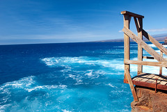 """Sit in reverie, and watch the changing color of the waves that break upon the idle seashore of the mind"" (WorldofArun) Tags: ocean blue vacation sky cliff color nature sport spec"