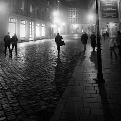 Heading Home : From darkness to light (Gilderic Photography) Tags: street city winter light shadow people urban bw white mist cinema black window lamp rain silhouette fog night dark walking square lumix moving europe raw noir mood darkness geometry hiver pluie nb ombre panasonic story lumiere slovensko slovakia cinematic rue nuit blanc bratislava brouillard brume fenetre obscurit pave lightroom lumineux reverbere bruine carre 500x500 slovaquie inmovimento gilderic superaplus aplusphoto lx3 dmclx3