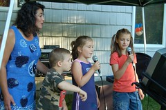 Singing in the Sun (GirlOnAMission) Tags: family party summer rachel jake suzy mckenzie 2007