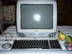 An apple next to an Apple iMac