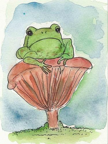 Frog sitting on mushroom