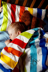 Rainbow Dreams (Kidzmom2009) Tags: sleeping baby cute colorful sweet innocent relaxing peaceful naturallight teddybear crib 21months rainbowcolored stripedbedding kidzmom2009 familygetty2010 kfsphotography