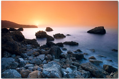 towards west (chris frick) Tags: longexposure sunset sea sun mist seascape rock clouds no tripod wideangle boulders filter mallorca tobacco cokin 8nd a550 remoteshuttercontrol chrisfrick towardswest sony1118mm 8gnd sonyalpha550 caladaia