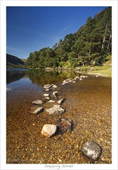 Stepping Stones (HaukeSteinberg.com) Tags: ireland lake mountains forest canon river landscape view pebbles irland berge glendalough steppingstones aussicht fluss wicklow landschaft upperlake ire sigma1020 nto 400d aplusphoto superbmasterpiece fineimage irlgallery