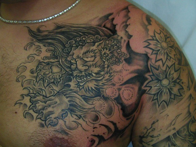 Detail of foo dog body suit tattoo design foo dog tattoo