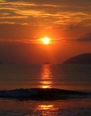 Here Comes The Sun (R. Aoki) Tags: light shadow sea brazil sky sun color reflection luz sol praia beach water gua brasil sunrise mar sopaulo sombra cu reflexo cor maranduba soe nascerdosol shieldofexcellence superbmasterpiece
