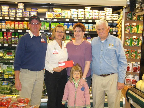 Marty and Janet Maidment, owners of Bayfield Foodland, presented Theresa Feeney, of Mitchell, and her daughter, Mallory, with a food voucher worth $400 recently. The voucher was donated by the grocery store as a door prize at the Bayfield Lions' Club's Home and Garden Show held in April. Charlie Kalbfliesch (left) represented the Bayfield Lions' Club at the prize presentation. (Submitted Photo)