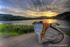 in the end...knackered! (gobayode photography...times) Tags: landscape aged retirement ladybowerreservoir angling drydocks oldfishingboat derbyshirelandscape anglingboat anglinginderbyshire sunsetonladybower peakforestnationalpark damagedboat agedboat ladybowerfisheries fishingladybower