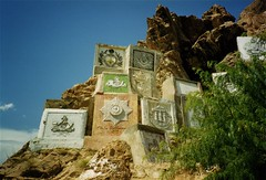 British Regimental emblems on the Khyber Pass, between Pakistand and Afghanistan (Charlie Phillips) Tags: pakistan afghanistan army arms coat britisharmy emblems northwestfrontier khyberpass regiments landikotal regimmental