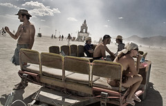 Moseying Along The Playa ('SeraphimC) Tags: panorama rain clouds canon rainbow desert wind nevada w playa burningman blackrockcity rebelxt 1855 dust setting duststorm 2007 lostfound blackrock radicalselfexpression drcarlsdepartmentofcollections doctorcarls 430andarctic