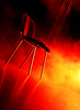 Empty chair on stage (Rune T) Tags: show light red yellow iso800 chair angle stage smoke burning event lonely tilt rtphoto