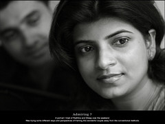 Admiring ? (rkmenon) Tags: family portrait blackandwhite bw india monochrome smile sepia canon eos 50mm eyes dof faces ravi portraiture 18 familyportrait 30s bharat shallowdof radhika admire dileep rkmenon