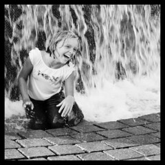 Smile + Flow (Ralph Krawczyk Jr) Tags: blackandwhite music motion brick wet water girl smile digital happy child action teeth nikond50 foam laughter splash isamunoguchi spaceage 313 detroitmichigan memorialfountain detroitinternationaljazzfestival nikon50mmf18d ralphkrawczykjr horaceedodge