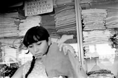 072970 14 13 (ndpa / s. lundeen, archivist) Tags: blackandwhite bw woman monochrome sign shop mexico island blackwhite clothing village market nick yucatan july clothes shelf mexican yucatán ponytail local 1970 brunette 1970s mujeres shelves isla islamujeres yucatanpeninsula dewolf nickdewolf photographbynickdewolf