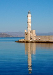 Venetian Lighthouse of Chania on the Greek island of Crete (Peace Correspondent) Tags: lighthouse seascape reflection d50 island harbor nikon europe mediterranean kreta eu icon greece crete hania fv10 iconic southerneurope chania kriti greekisland cotcmostinteresting 5photosaday views1250 venetianlighthouse chanea cretansea