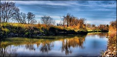 Fall By The River (Wenspics) Tags: blue autumn trees sky reflection fall nature water colors clouds river interestingness bravo rocks skies explorer clear riverbank wpt nohdr anawesomeshot