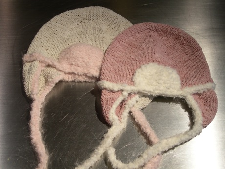 White and pink suede baby hats