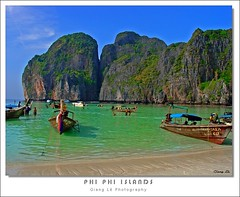 phi phi islands | thailand (milleluce.com) Tags: ocean sea sky people cliff green beach water thailand boats rocks asia phi vivid explore leh breathtaking bestofflickr giang themoulinrouge naturesfinest blueribbonwinner exemplary 10faves fineartphotos beautifulcapture flickrgold flickrfavoritephotographers aplusphoto amazingamateur naturewatcher colourartaward artlegacy excapture proudshopper theperfectphotographer giangle astoundingimages fotogezgintravelphotographer giangleorg