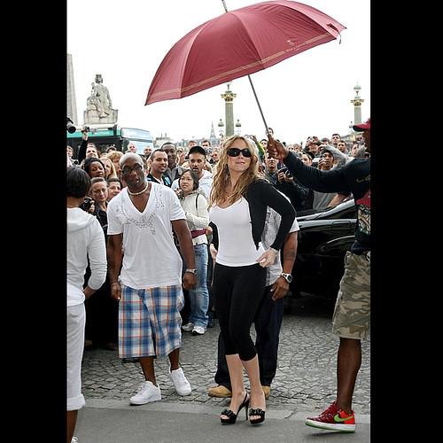 Mariah Carey brings her PUH (personal umbrella holder) to Paris, France
