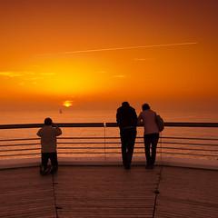 The Photographer :') (Tberga ) Tags: sunset pier zonsondergang scheveningen den nederland tourist photograph zomer avond haag oranje fotograaf itsnotacruiseship