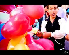 Selling balloons (Motaz Sonbol) Tags: boys festival kids canon fun happy kid play eid egypt baloons tamron1750 450d