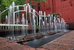 DSC_0015 (jreidfive) Tags: park red brick green water fountain virginia downtown fuzzy spray roanoke