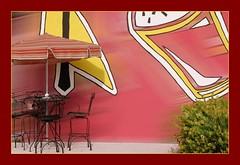 Windy Day (Carlos Porto) Tags: wall bush chair wind stool umbrela