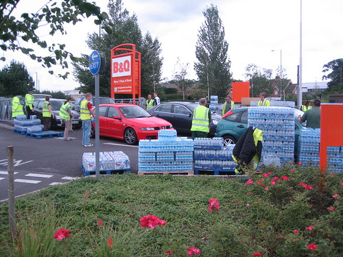 Cheltenham Borough Council staff help distribute water at B&Q