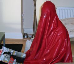 Me in red burqa reading closeup (latexladyll) Tags: ds rubber nun bdsm latex hood gag submission burqa enclosure veils