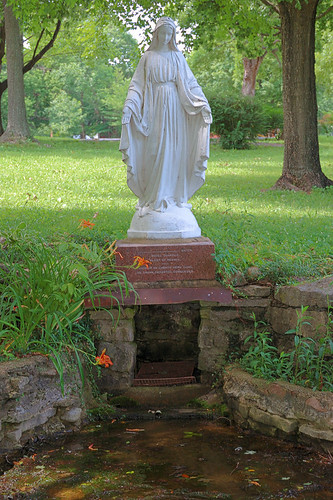 Sainte Marie du Lac Roman Catholic Church, in Ironton, Missouri, USA - statue of the Blessed Virgin Mary above spring source