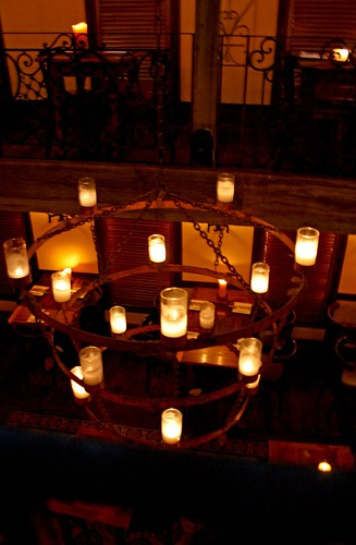 Large candlelit chandeliers hanging