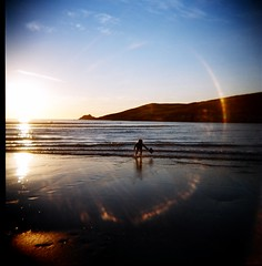 . (Rebecca...) Tags: sea sun 120 beach mediumformat lens holga cornwall fuji child play superia plasticfantastic flare 100asa 120n spectrumimaging