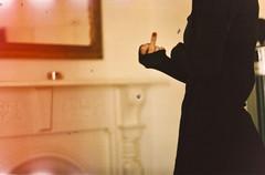 Bite. (Xiangk) Tags: film girl 35mm fuck you finger nail polish dirty attitude