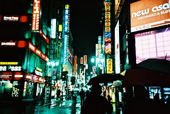 color of raining night (* andrew) Tags: lighting street color film silhouette japan night umbrella tokyo lomo lca crossprocessed xprocess shinjuku neon ct slide  100 agfa raining  32mm precisa  rainatnight